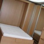 Кровать-шкаф с подъемным механизмом