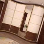 Преимущества угловых радиусных шкафов